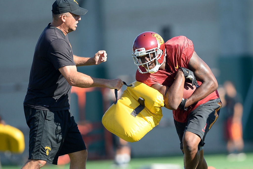 . Darreus Rogers carries the ball during practice August 27, 2014 on USC\'s Howard Jones Field.(Andy Holzman/Daily News Staff Photographer)