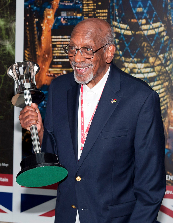 . US former athlete Harrison Dillard, the oldest living 100 metre gold medalist, displays the 1948 Olympic Torch, in London, Wednesday, Aug.1, 2012.  Britain\'s Foreign Office honored the 89-year-old American in London on Wednesday and allowed Dillard to hold the 1948 Olympic torch again. (AP Photo/ Will Oliver, Pool)