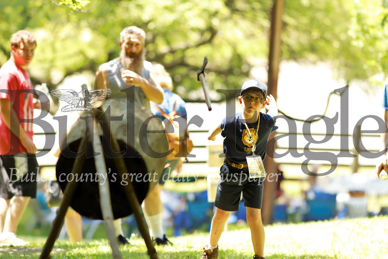 Anthony Edwards tosses an axe at a log target during Early American Day Saturday at the Old Stone House in Slippery Rock. Edwards was their with a number of members of his Boy Scout troop. Seb Foltz/Butler Eagle