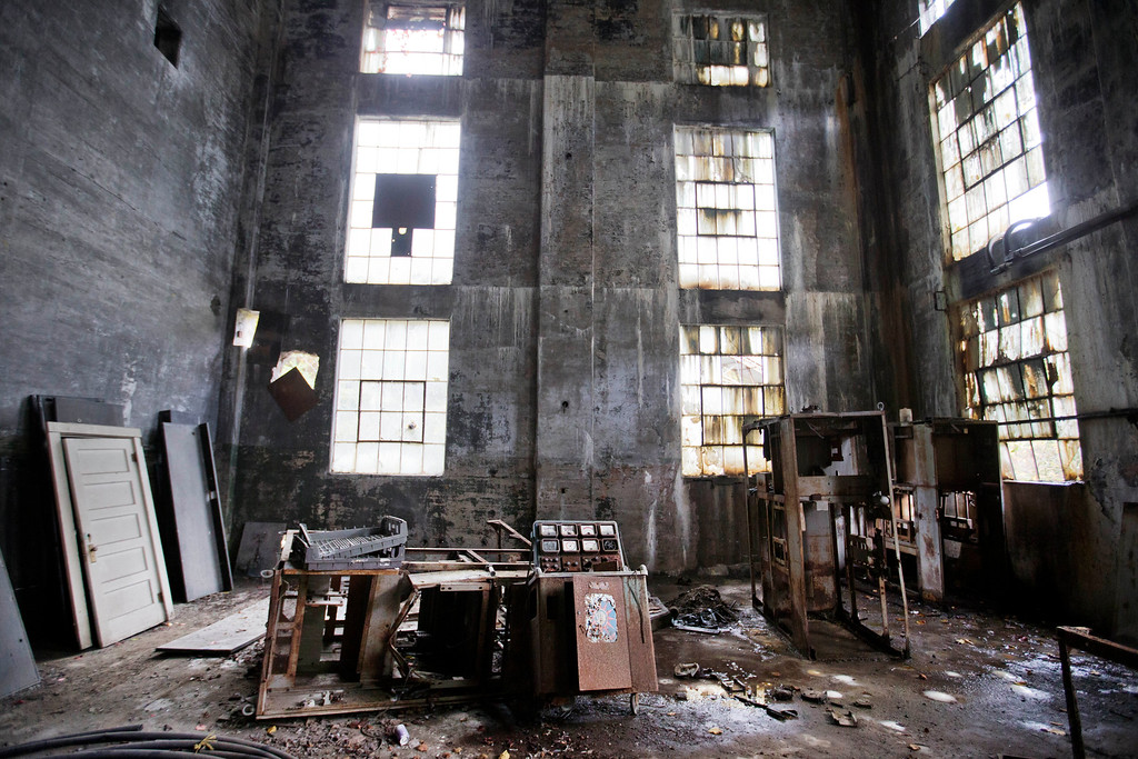 . In this Oct. 15, 2014 photo, rusted equipment sits on the floor of an abandoned coal power plant in Lynch, Ky. The community of Lynch, built as a company town in 1917 by U.S. Coal and Coke, a subsidiary of U.S. Steel, was at the time the largest coal camp in the world. It was built to house the many workers mining the coal to be used by U.S. Steel. The population peaked to around 10,000 but has since diminished to roughly 747 according to a 2010 census. The plant now sits abandoned across the street from the old mines that have since been turned into a museum. (AP Photo/David Goldman)