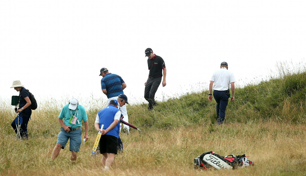 . US golfer Jimmy Walker (2nd R) looks for his ball in the rough on the14th hole during his fourth round 73, on the final day of the 2014 British Open Golf Championship at Royal Liverpool Golf Course in Hoylake, north west England on July 20, 2014.    ANDREW YATES/AFP/Getty Images