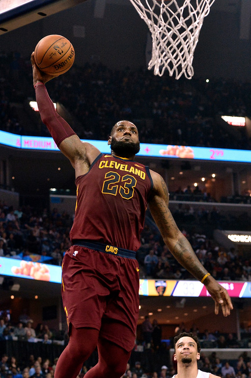 . Cleveland Cavaliers forward LeBron James (23) goes up for a dunk during the first half of an NBA basketball game against the Memphis Grizzlies on Friday, Feb. 23, 2018, in Memphis, Tenn. (AP Photo/Brandon Dill)