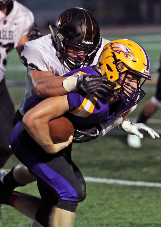 . Randy Meyers - The Morning Journal<br> Avon quarterback Ryan Maloy is brought down after a short gain by North Olmsted\'s Darren Anders during the second quarter on Sept. 14.