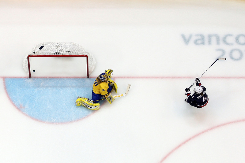 . Angela Ruggiero #4 of the United States scores past Kim Martin #30 of Sweden during the ice hockey women\'s semifinal game between Sweden and USA on day 11 of the Vancouver 2010 Winter Olympics at Canada Hockey Place on February 22, 2010 in Vancouver, Canada.  (Photo by Cameron Spencer/Getty Images)