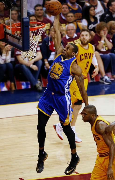 . Golden State Warriors guard Andre Iguodala (9) goes up for a dunk over Cleveland Cavaliers forward James Jones (1) during the first half of Game 4 of basketball\'s NBA Finals in Cleveland, Thursday, June 11, 2015. (AP Photo/Paul Sancya)
