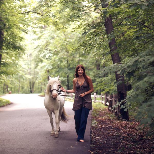 """July 72 / Ann loves her """"little pony""""."""