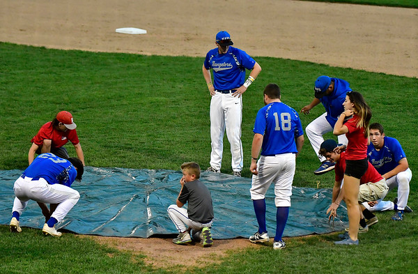 8/8/2019 Mike Orazzi | Staff The pitchers mound gets covered during a rain delay at Thursday evenings Bristol Blues playoff game with the North Shore Navigators at Muzzy Field in Bristol.