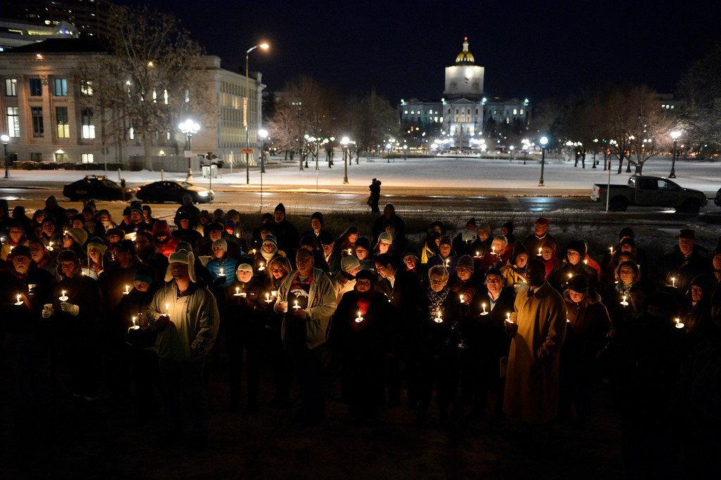 . People gathered on the steps of the City & County Building to pay their respect to the homeless men, women and children who have passed away as they hold candles during the ceremony Wednesday, December 19, 2012. Mayor Hancock read some of the 147 names of those who have perished. John Leyba, The Denver Post