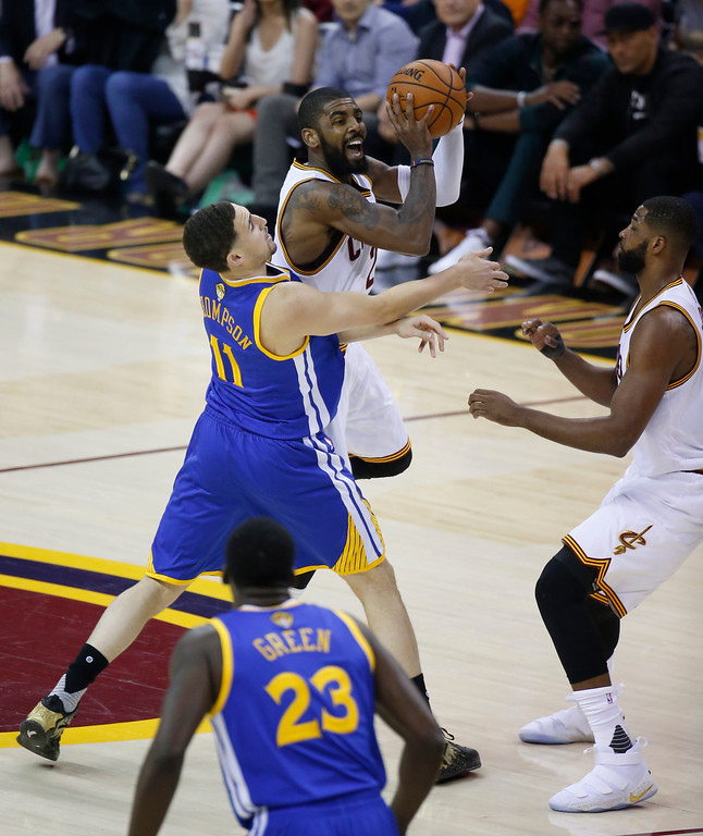 . Cleveland Cavaliers guard Kyrie Irving shoots over Golden State Warriors guard Klay Thompson (11) during the first half of Game 4 of basketball\'s NBA Finals in Cleveland, Friday, June 9, 2017. (AP Photo/Ron Schwane)