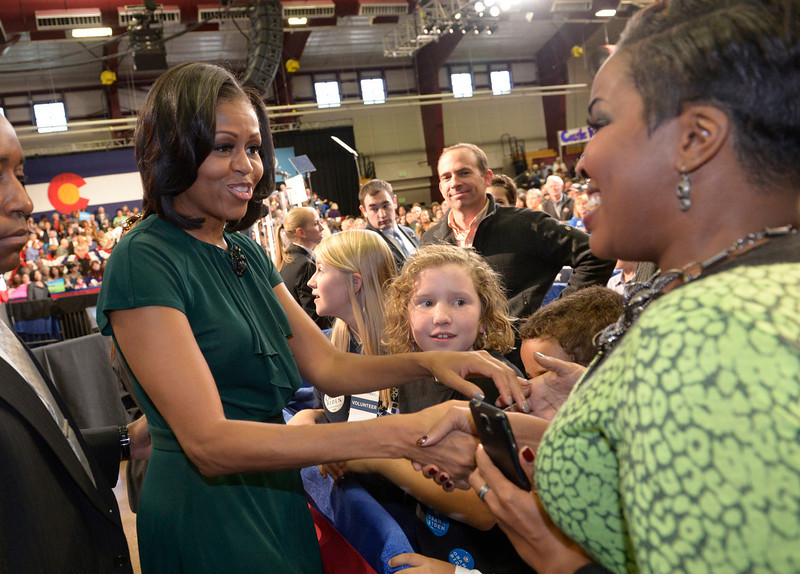 . Michelle Obama shakes hands with fans after her speech. First Lady Michelle Obama was in Colorado for a second day  today October 11, 2012 to speak to grassroots supporters in Castle Rock.  She spoke about what is at stake in this election for Coloradoans and encourage them to help organize their communities between now and election day. She spoke at the Douglas County Fairgrounds in Castle Rock.  Yesterday she visited Fountain and Durango.  Helen H. Richardson, The Denver Post