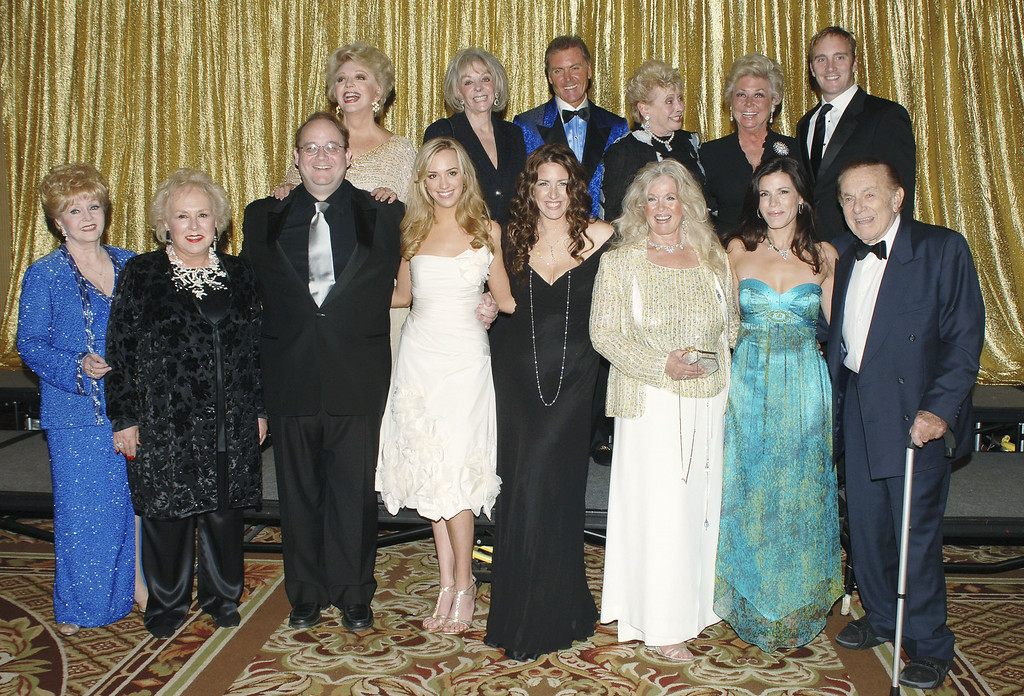 . (L-R, front row) Actor Debbie Reynolds, actor Doris Roberts, producer Marc Cherry, actor Joely Fisher, actor Connie Stevens, actor Trisha Leigh Fisher and comedian Jack Carter (L-R, back row) actor Ruta Lee, 3 guests, actor Mitzi Gaynor and actor Jay Mohr attend the 51st Annual Thalians Ball at the Hyatt Regency Century Plaza Hotel on October 7, 2006 in Century City, California.  (Photo by Stephen Shugerman/Getty Images)