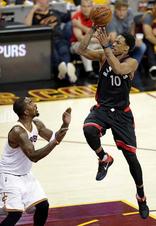 . Toronto Raptors\' DeMar DeRozan, right, shoots over Cleveland Cavaliers\' J.R. Smith in the first half in Game 1 of a second-round NBA basketball playoff series, Monday, May 1, 2017, in Cleveland. The Cavaliers won 116-105. (AP Photo/Tony Dejak)