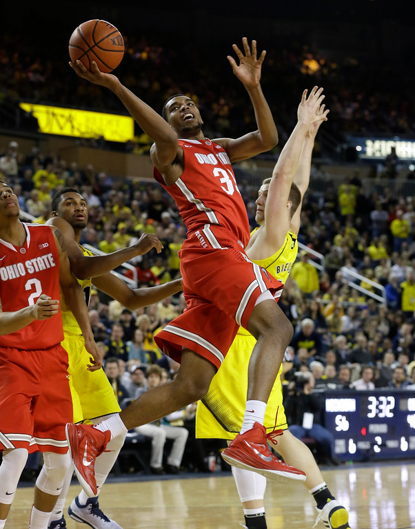 . Ohio State forward Keita Bates-Diop makes a lay up during the second half of an NCAA college basketball game against Michigan, Sunday, Feb. 22, 2015 in Ann Arbor, Mich. Michigan defeated Ohio State 64-57. (AP Photo/Carlos Osorio)