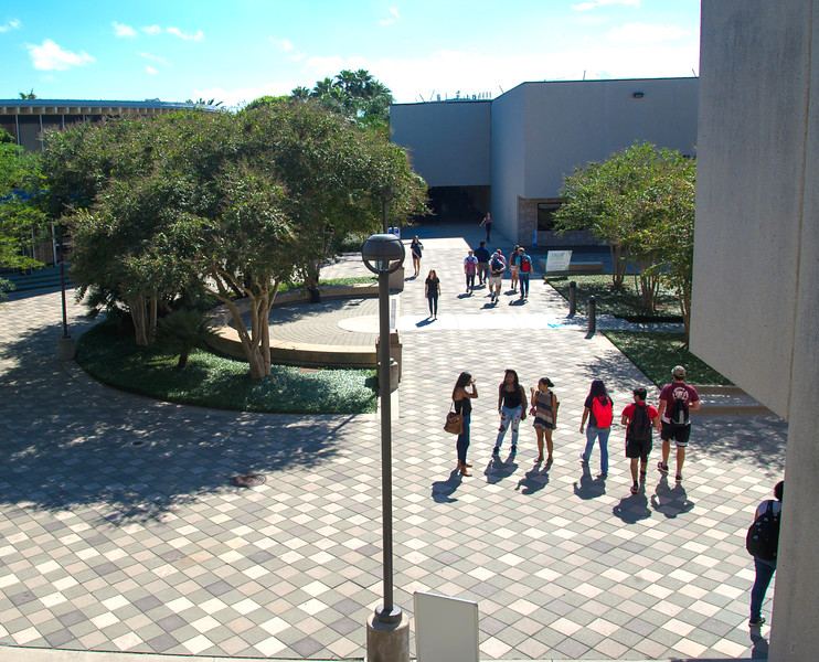 Students walk through Lee Plaza to get to their next class.