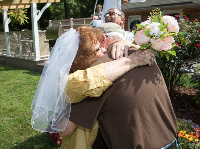 Mam and Badge Embracing at the Altar 2.jpg