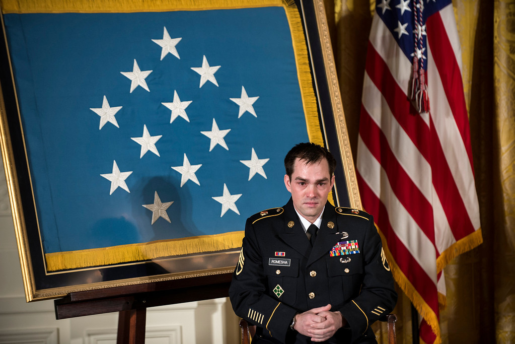 . Retired Army Staff Sargent Clinton Romesha listens during a Medal of Honor ceremony in the East Room of the White House on February 11, 2013 in Washington.    AFP PHOTO/Brendan  SMIALOWSKI/AFP/Getty Images