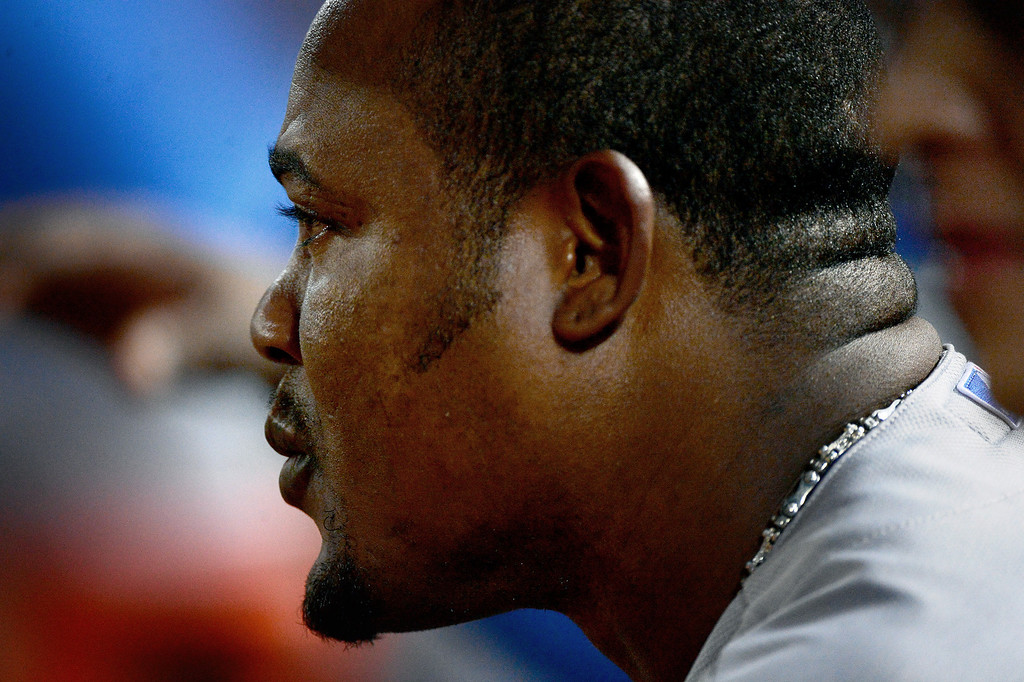 . Los Angeles Dodgers\' Juan Uribe sits in the dugout as they defeat the Atlanta Braves 6-1 in the first game of the playoffs Thursday, October 3, 2013 at Turner Field in Atlanta, Georgia. (Photo by Sarah Reingewirtz/Pasadena Star- News)