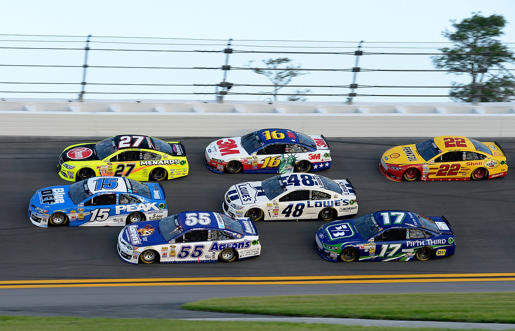 . DAYTONA BEACH, FL - JULY 06:  (L-R) Clint Bowyer, driver of the #15 Blue DEF Diesel Exhaust Fluid Toyota, Paul Menard, driver of the #27 Rheem / Menard\'s Chevrolet, Michael Waltrip, driver of the #55 Aaron\'s Dream Machine Toyota, Greg Biffle, driver of the #16 3M Ford, Jimmie Johnson, driver of the #48 Lowe\'s Dover White Chevrolet, Ricky Stenhouse Jr., driver of the #17 Fifth Third Ford, and Joey Logano, driver of the #22 Shell Pennzoil Ford, race three wide during the NASCAR Sprint Cup Series Coke Zero 400 at Daytona International Speedway on July 6, 2013 in Daytona Beach, Florida.  (Photo by John Harrelson/Getty Images)