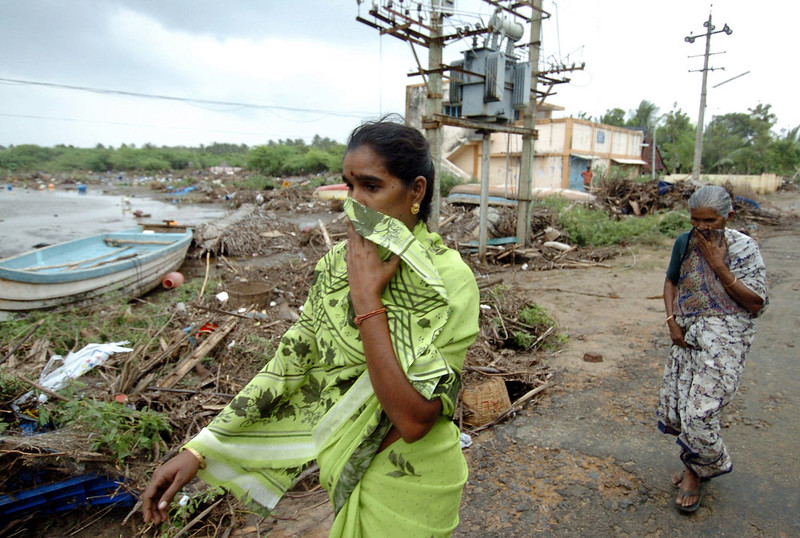 . Women cover their faces as they walk through the devastated Karmavadi village in the Nagapattinam district, some 350 km south of Madras on December 27, 2004, after tidal waves hit the region. The death toll in southern India from tidal waves that battered much of Asia crossed 6,800 Monday with thousands still missing, officials said. The official count of 6,823 dead included some 3,000 in the Andaman and Nicobar Islands, close to the epicenter of the Indonesian earthquake that caused the tsunamis, and another 3,600 in the southern Indian state of Tamil Nadu and the former French colony of Pondicherry.  PRAKASH SINGH/AFP/Getty Images