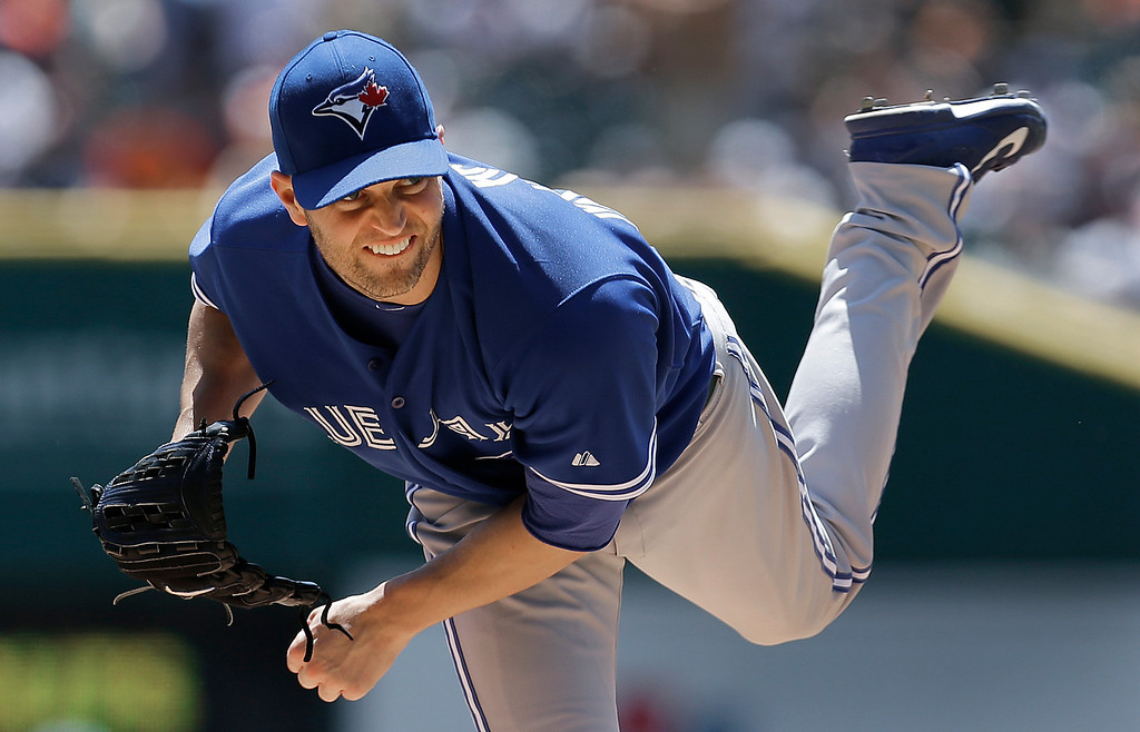 . Toronto Blue Jays pitcher J.A. Happ throws against the Detroit Tigers in the first inning of a baseball game in Detroit, Thursday, June 5, 2014. (AP Photo/Paul Sancya)