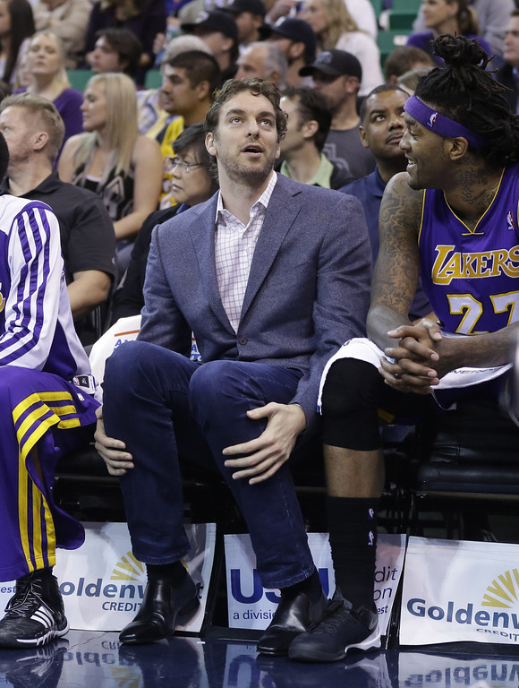 . Los Angeles Lakers\' Pau Gasol looks on as he sits on the bench in the second half during an NBA basketball game Monday, April 14, 2014, in Salt Lake City, Utah. (AP Photo/Rick Bowmer)