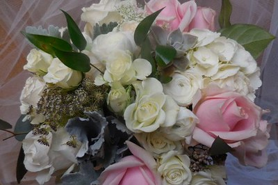 White hydrangea pink, ivory roses, spray ross, grey miller succulents  $135