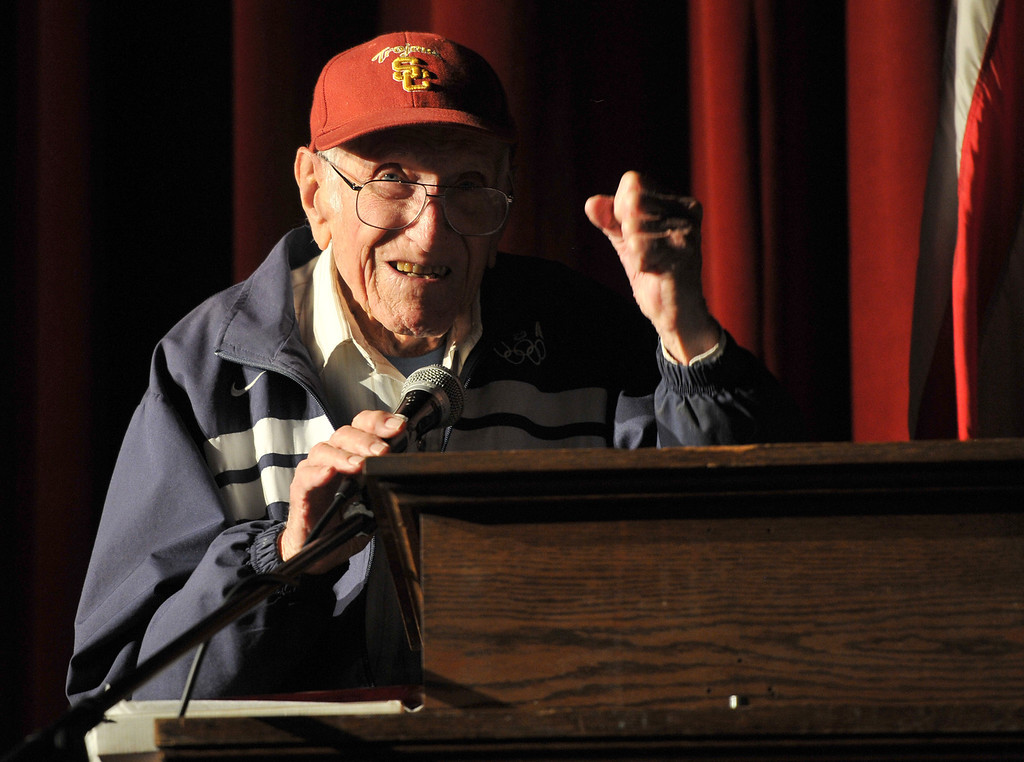 . Torrance---3/31/11---Daily Breeze Photo:  Robert Casillas ---  Torrance legend Louis Zamperini paid a visit to his alma mater Torrance High to visit with alumni and meet students. Zamperini pumps his fist to acknowledge cheers from students.