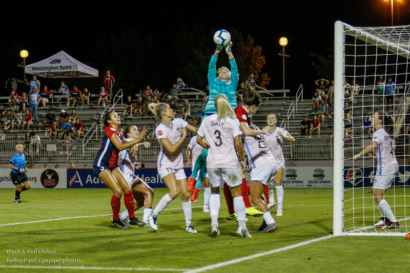 Houston Dash goalkeeper Jane Campbell (1) makes a save at Maureen Hendricks Field in Boyds, MD, on July 20, 2019.