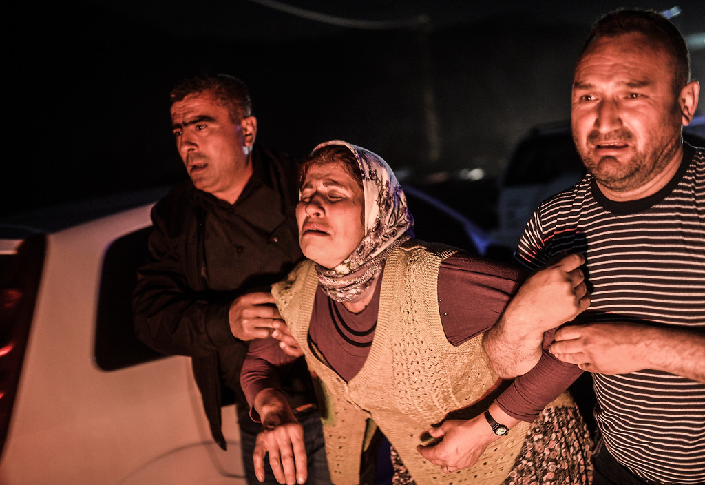 """. People cry after their relatives died in an explosion in Manisa on May 13, 2014. Four miners were killed and as many as 300 trapped after a mine collapse in the western Turkish city of Manisa, a local official said. \""""At least 200-300 workers were working in the mine when an electric fault caused an explosion,\"""" the mayor of Soma, a district of Manisa, told private NTV television. AFP PHOTO/BULENT KILIC/AFP/Getty Images"""