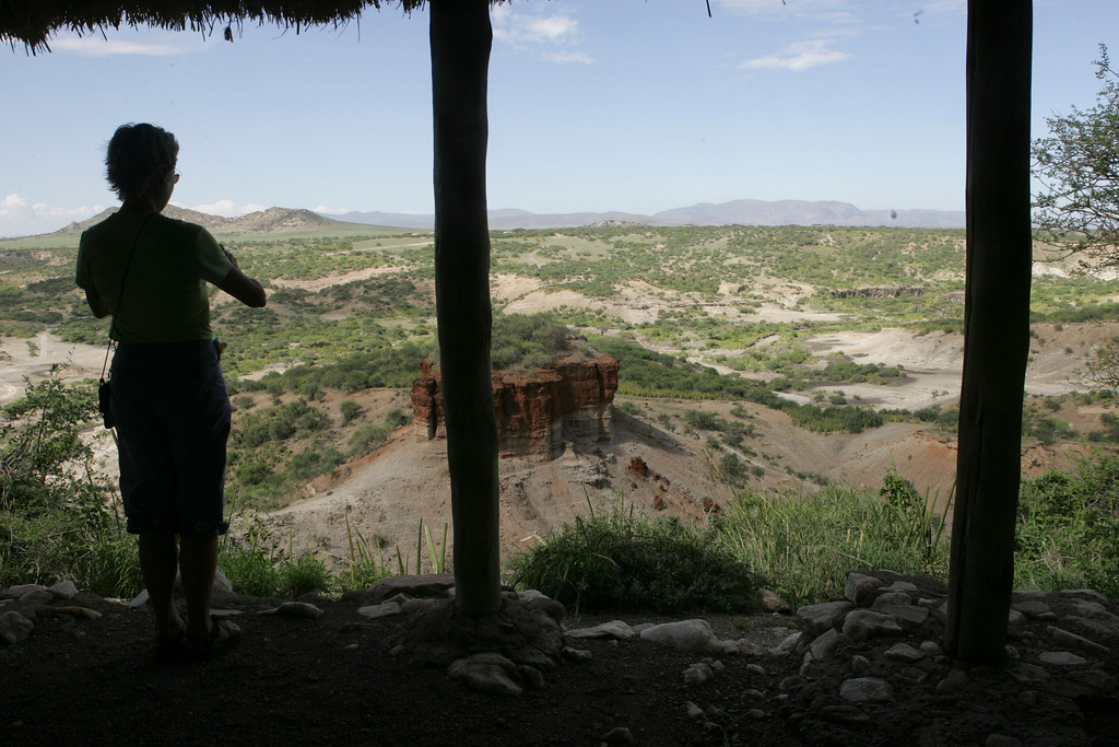 . A tourist looks out over the Olduval Gorge, one of the most important paleoanthropological sites in the world. Here, remains of humans 1.75 million years old were discovered, in Tanzania, Africa.