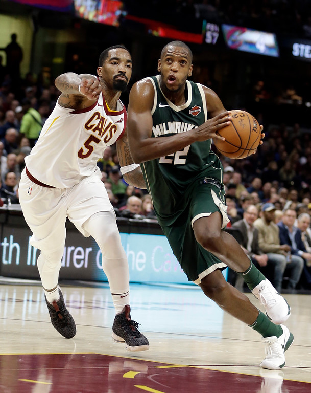 . Milwaukee Bucks\' Khris Middleton (22) drives against Cleveland Cavaliers\' JR Smith (5) in the second half of an NBA basketball game, Tuesday, Nov. 7, 2017, in Cleveland. The Cavaliers won 124-119. (AP Photo/Tony Dejak)