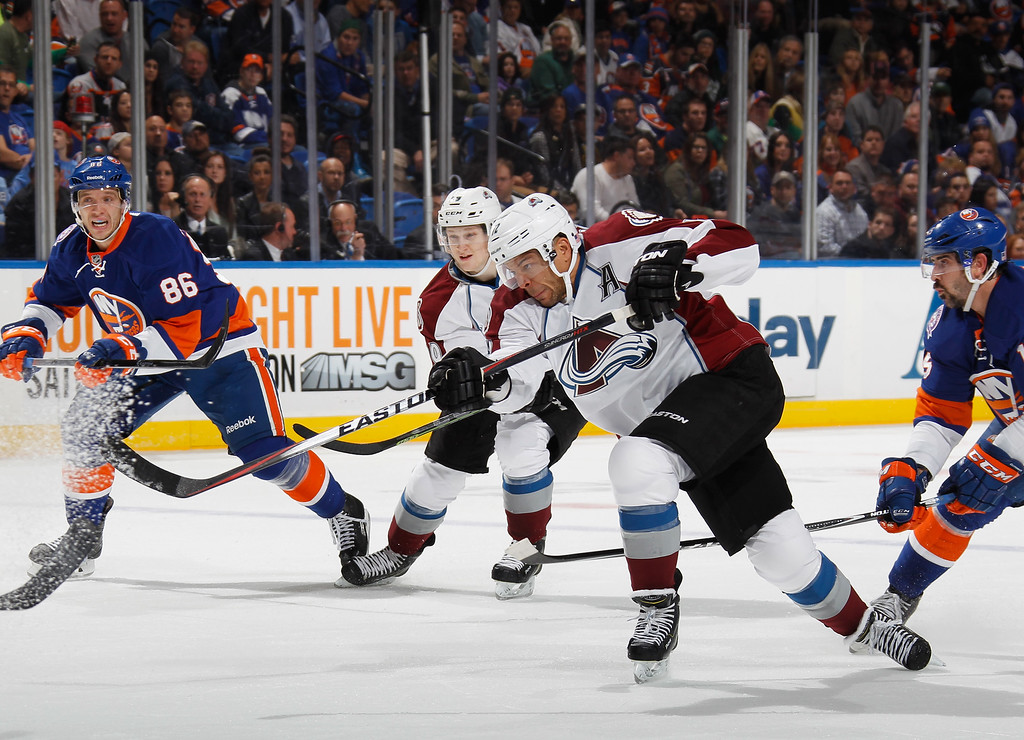 . UNIONDALE, NY - NOVEMBER 11: Jarome Iginla #12 of the Colorado Avalanche takes the first period shot against the New York Islanders at the Nassau Veterans Memorial Coliseum on November 11, 2014 in Uniondale, New York.  (Photo by Bruce Bennett/Getty Images)