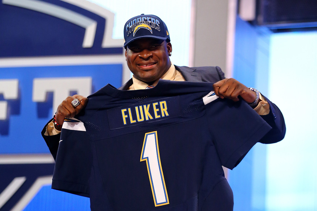 . D.J. Fluker of the Alabama Crimson Tide holds up a jersey on stage after he was picked #11 overall by the San Diego Chargers in the first round of the 2013 NFL Draft at Radio City Music Hall on April 25, 2013 in New York City.  (Photo by Al Bello/Getty Images)