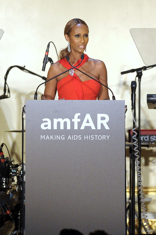 . NEW YORK, NY - JUNE 13:  Iman accepts the Award of Inspiration on behalf of Valentino Garavani (not pictured) during the 4th Annual amfAR Inspiration Gala New York at The Plaza Hotel on June 13, 2013 in New York City.  (Photo by Michael Loccisano/Getty Images)