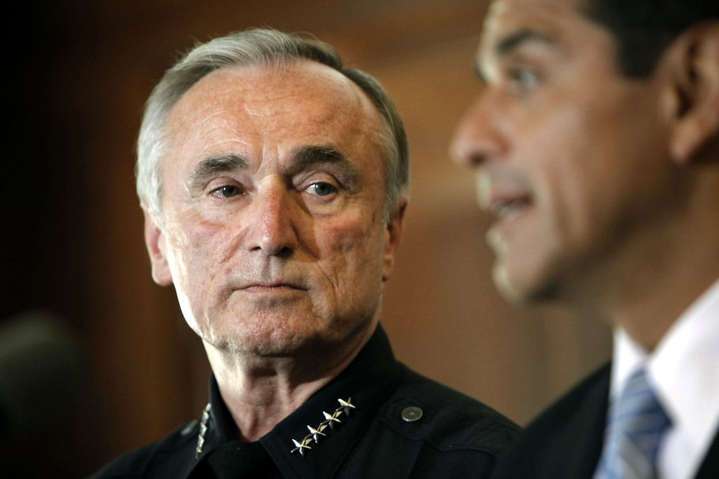 . LAPD Chief William Bratton listens as Mayor Antonio Villaraigosa announces Bratton\'s retiring from the LAPD, Wednesday, August 5, 2009, during a press conference at City Hall.