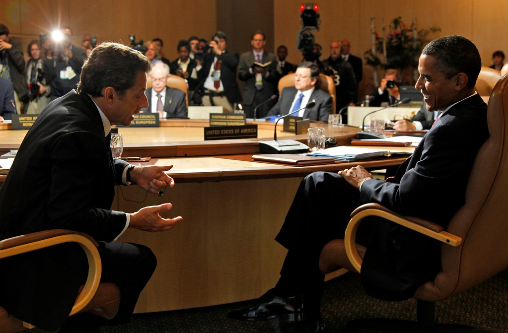 . President Barack Obama of the United States speaks with President Nicolas Sarkozy of France, left, as they attend a leaders working session at the G8 Summit at Deerhurst Resort in Huntsville, Ontario, Saturday, June 26, 2010. (AP Photo/Charles Dharapak, Pool)