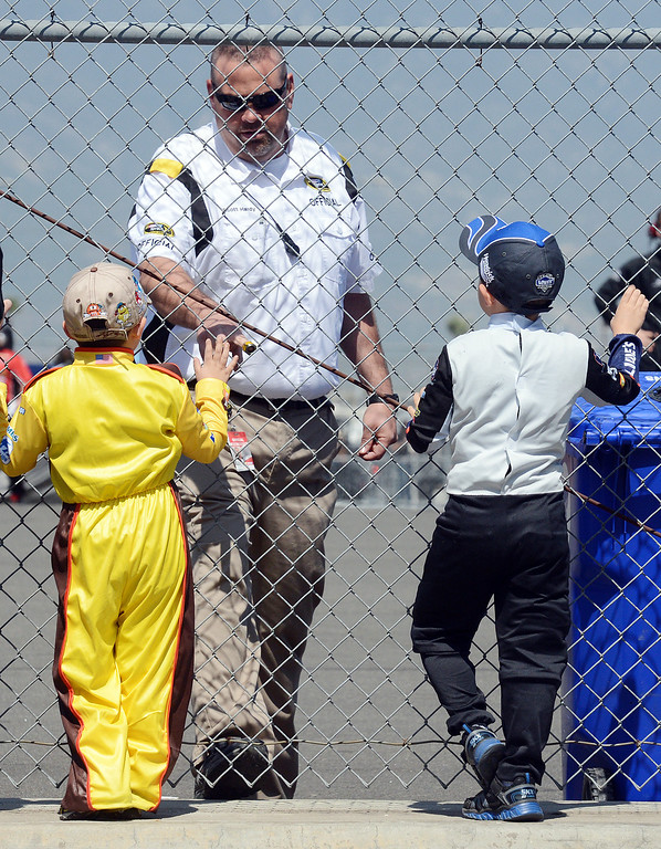. (Will Lester/Staff Photographer) A NASCAR official greets fans Evan Shortle (left), 4 from Seal Beach, and his older brother Easton, 5,  Friday March 22, 2013 at Auto Club Speedway in Fontana.