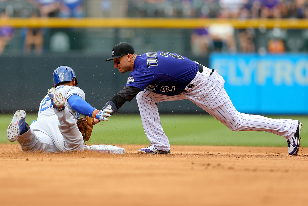 . DENVER, CO - JUNE 7:  Matt Kemp #27 of the Los Angeles Dodgers is caught trying to stretch a single into a double as Troy Tulowitzki #2 of the Colorado Rockies applies the tag for the second out of the second inning at Coors Field on June 7, 2014 in Denver, Colorado. (Photo by Justin Edmonds/Getty Images)
