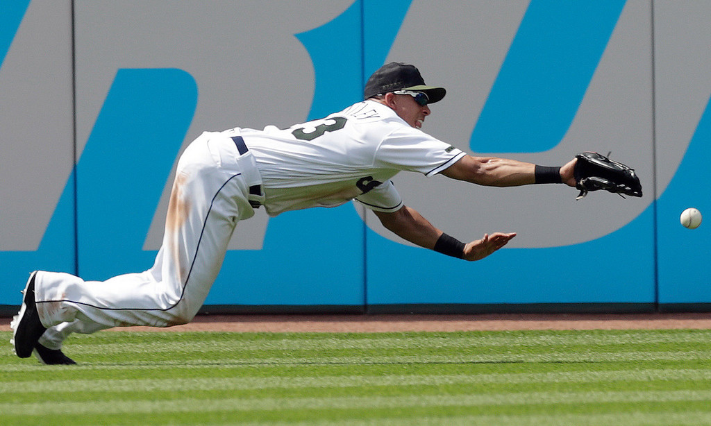 . Cleveland Indians\' Michael Brantley dives for a ball hit by Houston Astros\' George Springer in the eighth inning of a baseball game, Sunday, May 27, 2018, in Cleveland. Springer was safe at second base for a double. (AP Photo/Tony Dejak)