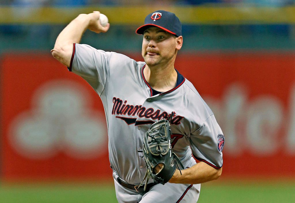 . Twins starting pitcher Mike Pelfrey throws during the first inning of a baseball game against the Rays. (AP Photo/Mike Carlson)