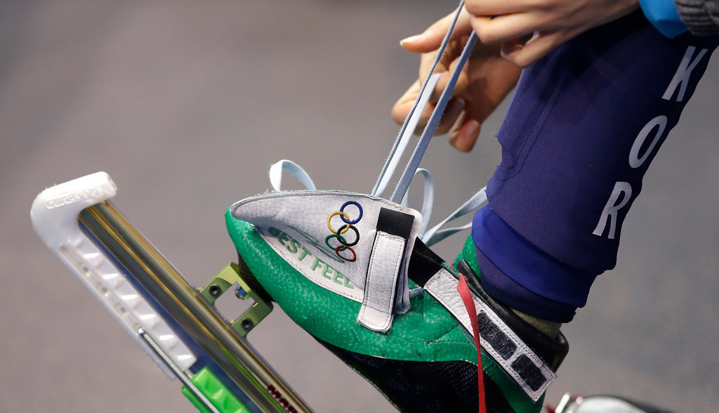 . Shim Suk-Hee of South Korea laces up before competing in a women\'s 1000m short track speedskating semifinal at the Iceberg Skating Palace during the 2014 Winter Olympics, Friday, Feb. 21, 2014, in Sochi, Russia. (AP Photo/Darron Cummings)