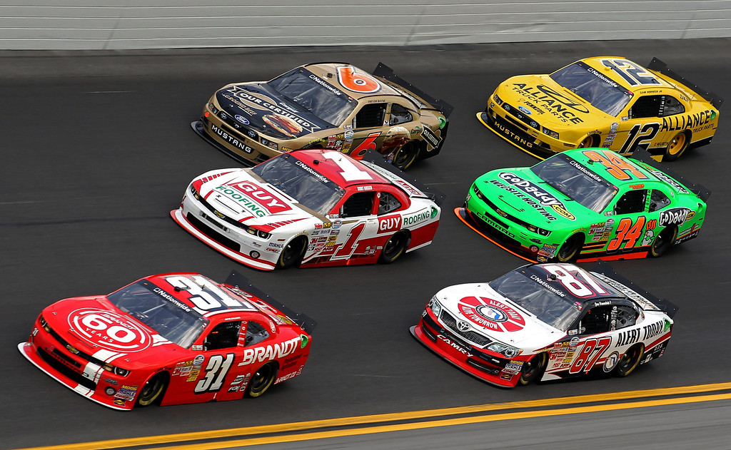. DAYTONA BEACH, FL - FEBRUARY 23: Justin Allgaier, driver of the #31 Brandt Chevrolet, Kurt Busch, driver of the #1 Guy Roofing Chevrolet, Trevor Bayne, driver of the #6 Cargill Ford, Joe Nemechek, driver of the #87 HostGator.com Chevrolet, Danica Patrick, driver of the #34 GoDaddy.com Chevrolet, Sam Hornish Jr., driver of the #12 Alliance Truck Parks Ford, race during the NASCAR Nationwide Series DRIVE4COPD 300 at Daytona International Speedway on February 23, 2013 in Daytona Beach, Florida.  (Photo by Todd Warshaw/Getty Images)