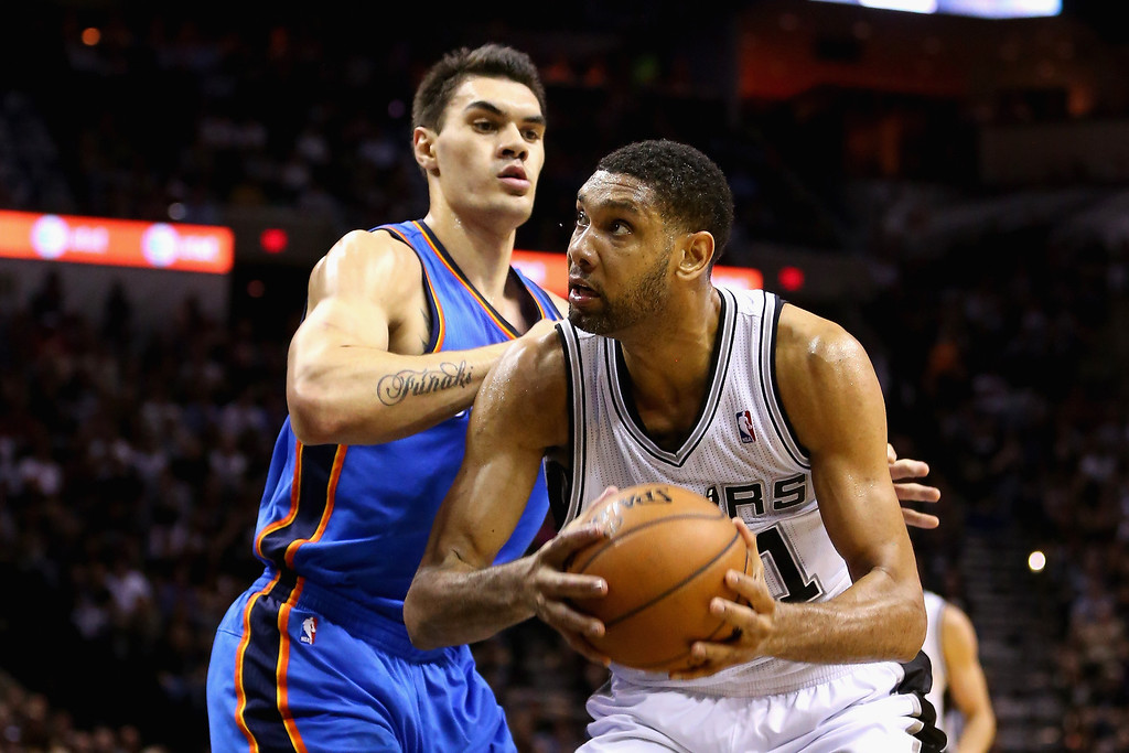 . Tim Duncan #21 of the San Antonio Spurs drives to the basket against Steven Adams #12 of the Oklahoma City Thunder in the second quarter during Game Five of the Western Conference Finals of the 2014 NBA Playoffs at AT&T Center on May 29, 2014 in San Antonio, Texas.   (Photo by Ronald Martinez/Getty Images)