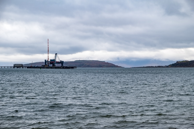 Cloudy Winter Arran with a Light Dusting of Snow and Hunterston Oar Terminal in the Foreground.