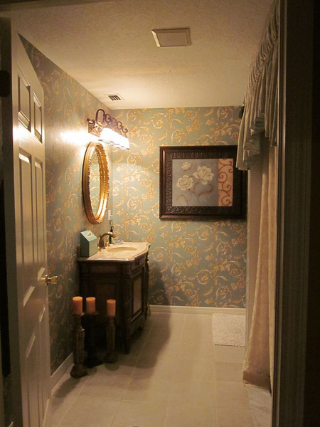 Handicap-accessible guest bathroom. This wallpaper isn't terrible, but it also isn't staying long.  I plan to re-wallpaper this bathroom with a map and travel theme.