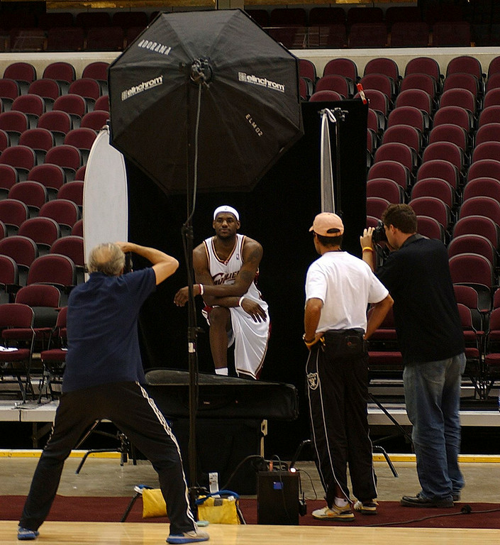 . MORNING JOURNAL/DAVID RICHARD Legendary Sports Illustrated photographer Walter Iooss, left, photographs LeBron James yesterday at Quicken Loans Arena during the the Cleveland Cavaliers\' Media Day. Iooss, also popular for his work with the world\'s top models, has had nearly 300 images appear on the cover of Sports Illustrated.