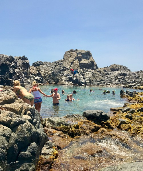 a natural pools surrounded by lava rock