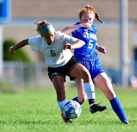 9/17/2019 Mike Orazzi | StaffrSt. Paul's Abbey Stanford (5) and Woodland's Jenna Mierek (6) during girls soccer?r in Bristol Tuesday afternoon.