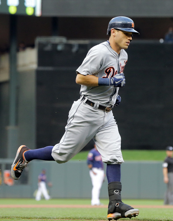 . Detroit Tigers\' Ian Kinsler heads for home on a solo home run off Minnesota Twins  pitcher Tommy Milone in the first inning of a baseball game, Friday, Aug. 22, 2014, in Minneapolis. (AP Photo/Jim Mone)