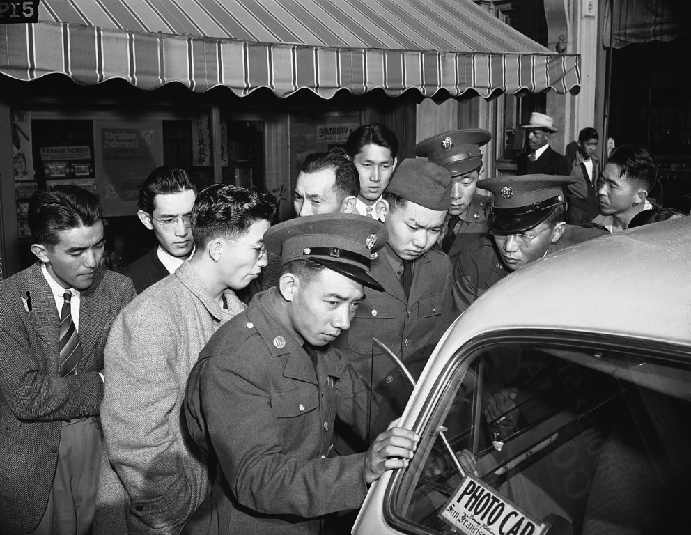 . Young Japanese Americans, including several Army selectees, gather around a reporter\'s car in the Japanese section of San Francisco, Dec. 8, 1941.  (AP Photo)